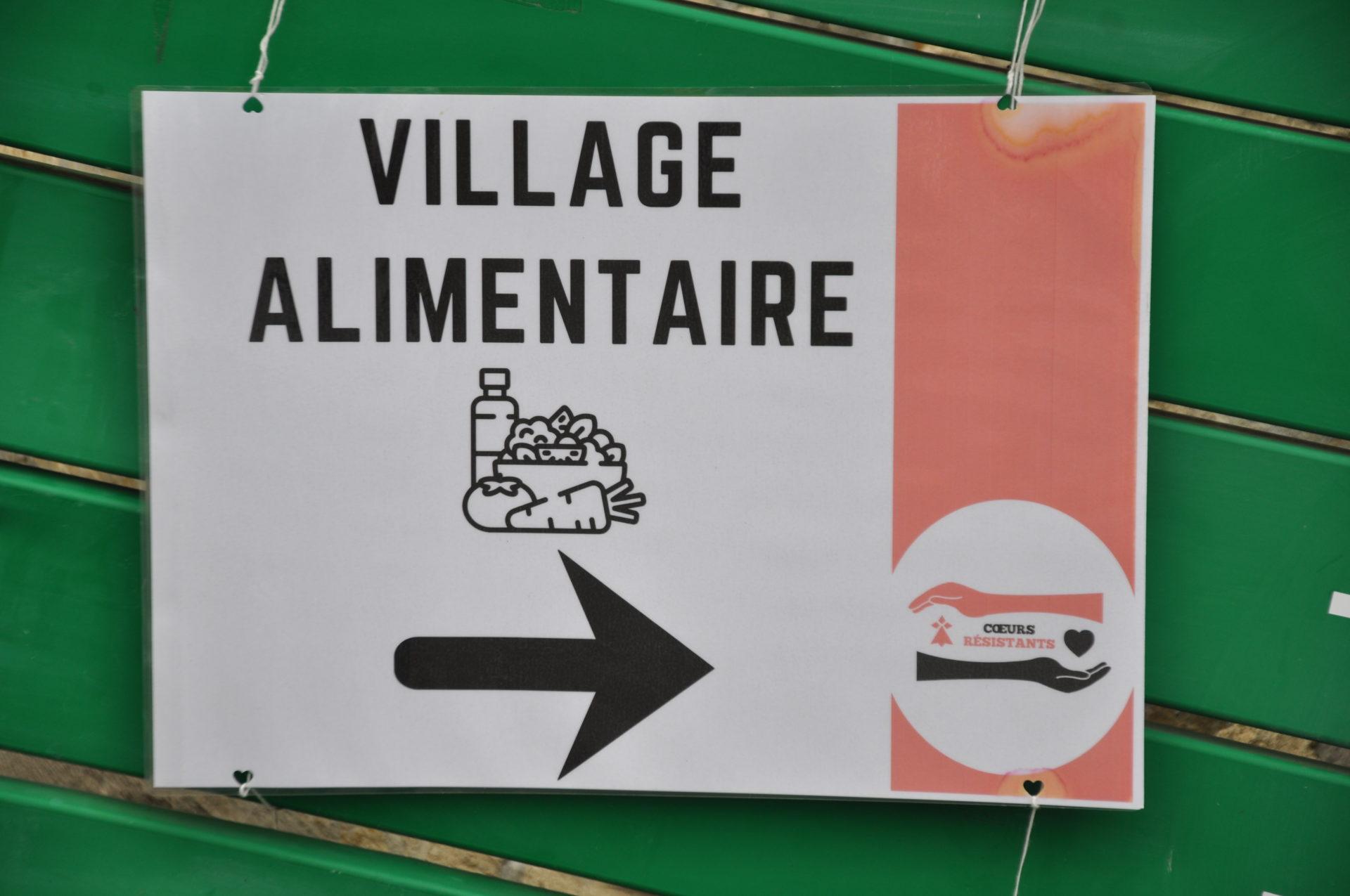 Affiche du Village Alimentaire avec le logo de Cœurs Résistants